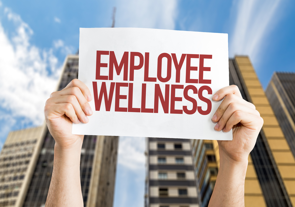 Employee Benefits placard with cityscape background-1
